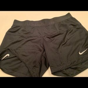 Nike breathable material shorts size small.